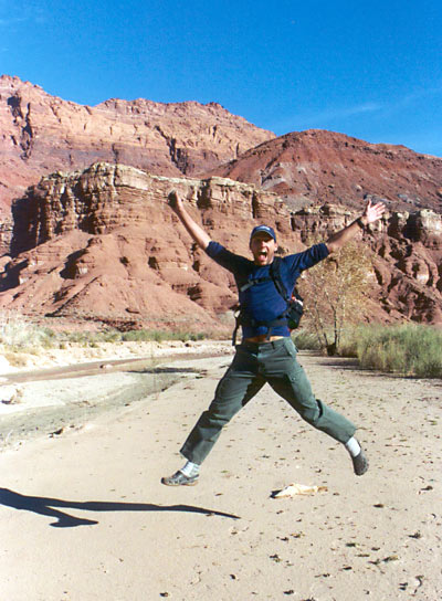 Aaron being silly and jumping while on a hike in Paria River Canyon