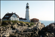 A lighthouse on the rocky shores of Maine